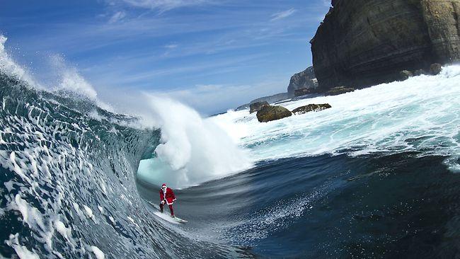 surfing santa merry christmas bodyline wetsuits